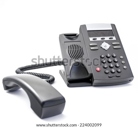 Close up of modern VOIP (voice over IP) telephone with receiver in perspective foreground view, isolated on white background. - stock photo