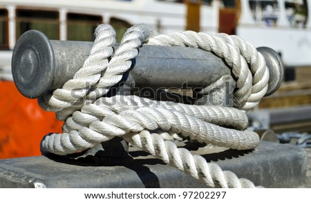 Close-up of mooring bollard with blue rope in marina of Eilat, Israel - stock photo