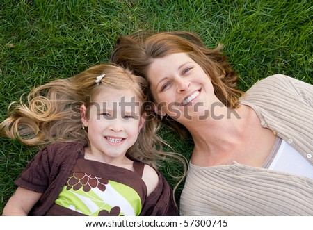 Close Up of Mother and Daughter - stock photo