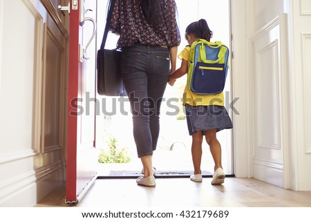 Close Up Of Mother And Daughter Leaving For School - stock photo
