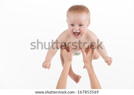 Close up of mother hands throwing up little baby. Cute baby laughing isolated over white background  - stock photo
