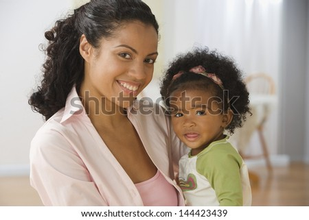 Close-up of mother holding baby - stock photo