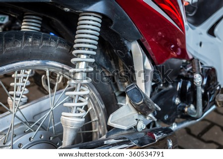 Close up of motorcycle shock absorber.