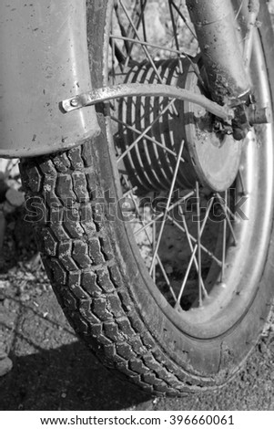 Close up of motorcycle wheel/ Black and white photo. Old vintage card. - stock photo