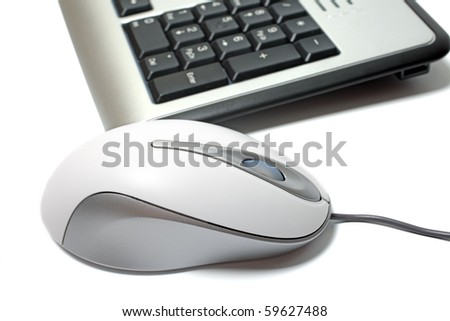 Close up of mouse and keyboard isolated on white background. - stock photo