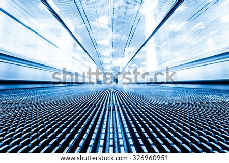 Close-up of moving escalator,motion blur - stock photo