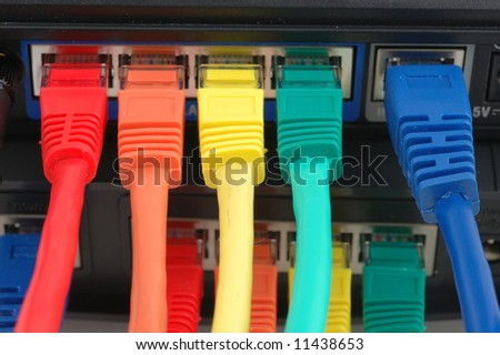 Close up of multi color cables connected to a router - stock photo