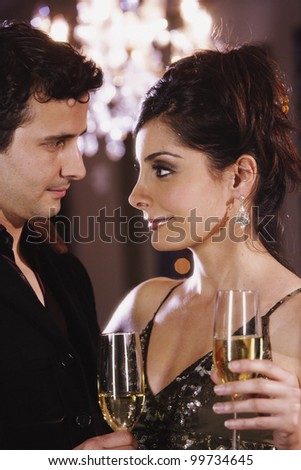 Close up of multi-ethnic couple smiling at each other - stock photo