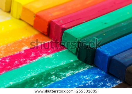 Close up of multicolor oil pastel crayons - stock photo