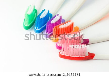 Close up of multicolor toothbrushes on white background