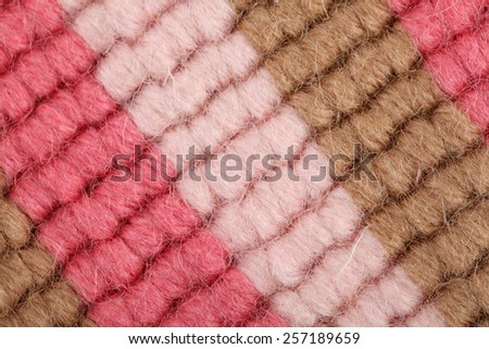 Close up of multicolor wool with detail of woven pattern - stock photo