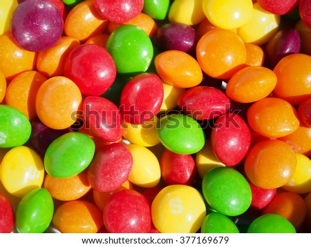 Close up of multicolored Skittles sweets - stock photo