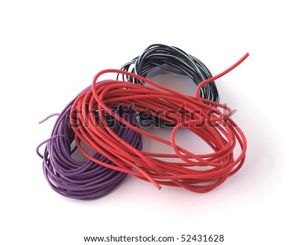 Close up of multicolored wire on a white background. - stock photo