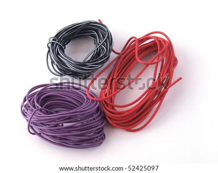 Close up of multicoloured wire on a white back ground. - stock photo