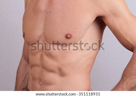Close up of muscular male torso and chest hair removal. Male Waxing