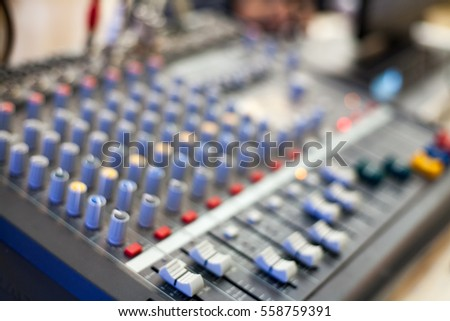 Close-up of music mixer button, setting volume. Music production mixer, adjustment tools
