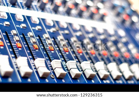 Close-up of music mixer in audio studio, ready for party - stock photo