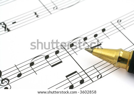 close-up of music note and ballpoint pen tip