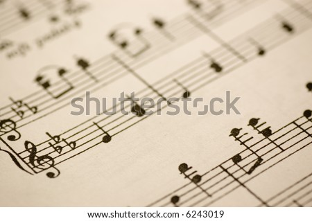 Close-up of musical notes printed on a music sheet