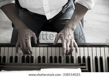 Close up of musician hands classic piano playing - stock photo
