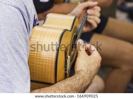 Close-up of musician playing the the cavaquinho - indispensable tool in the execution of Brazilian chorinho music music - stock photo