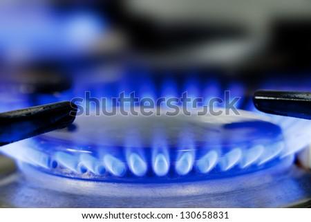 Close up of natural gas stove flames burning - stock photo