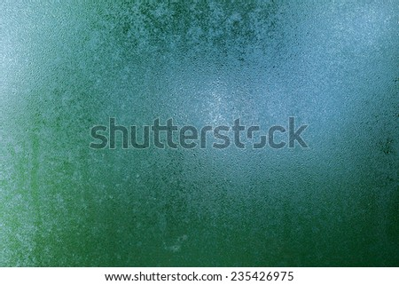 Close up of natural water drops on glass texture - stock photo
