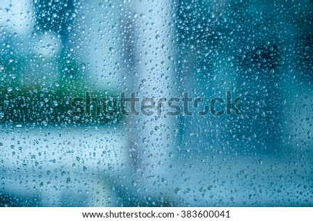 Close up of natural water drops on glass texture. - stock photo