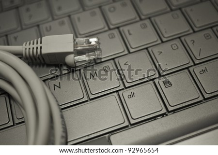 Close up of network cable on laptop keyboard