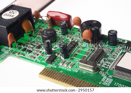 Close-up of  network card  with capacitors in front on white background - stock photo