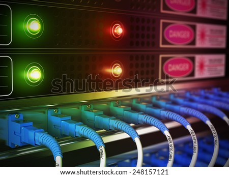 Close up of network infrastructure in data center. Blur effect with focus on patchcords at the foreground. - stock photo