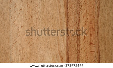 Close up of neutral brown freshly processed beech plank. Texture background with space for copy and text