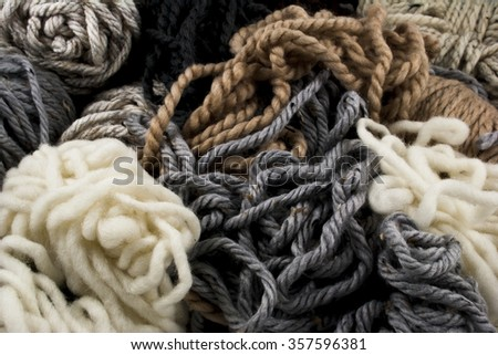 Close-up of neutral colored yarn scraps - stock photo