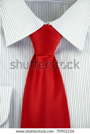 Close-up of new shirt with red silk necktie - stock photo