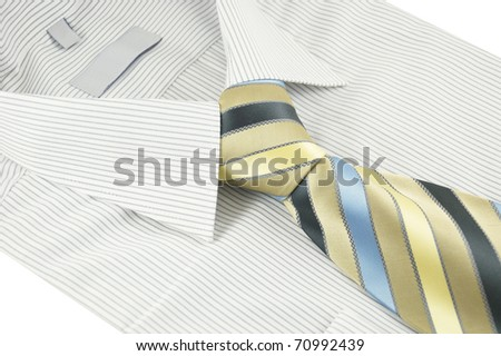 Close-up of new shirt with striped necktie on a white - stock photo