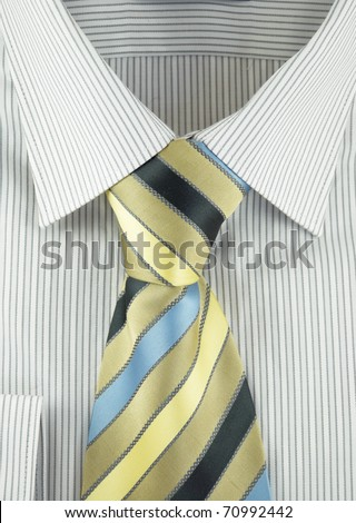 Close-up of new shirt with striped silk necktie - stock photo