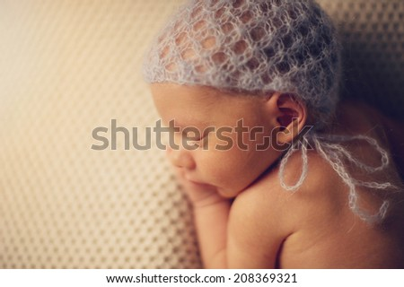 Close up of Newborn baby in Hat - stock photo