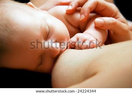 close up of newborn baby near breast - stock photo