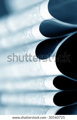 Close up of newspaper with headlines - stock photo
