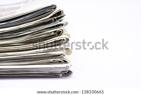 close up of newspapers on white background