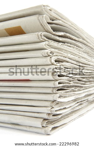 close up of newspapers on white background - stock photo
