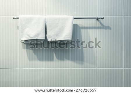 Close up of nice white towels on Clothes line in the bathroom - stock photo