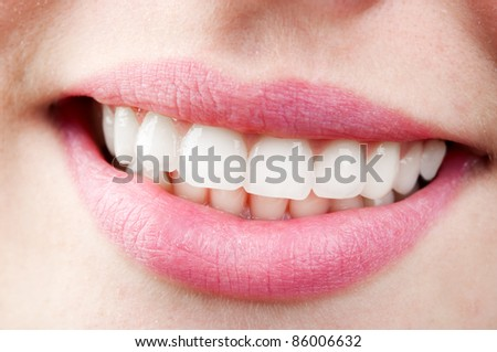 close up of nice young women's smile