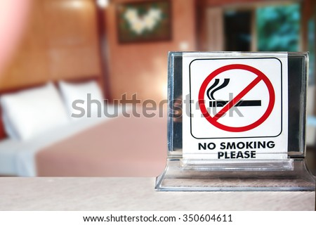 close-up of no smoking warning over bedroom or hotel background,abstract background for no smoking concept.