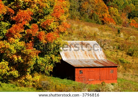 Close Up of North Carolina Red Barn in Autumn Horizontal - stock photo