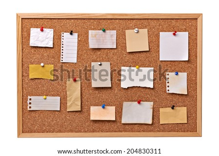 close up of note papers on a cork board - stock photo