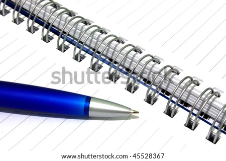 Close up of notebook and pencil. - stock photo