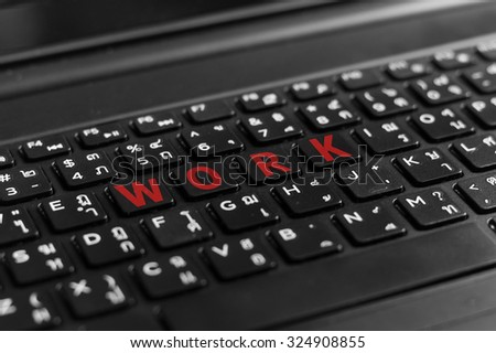 Close up of notebook black keyboard show letter work.