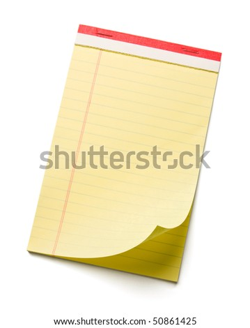 Close up of notepad with curled corner. - stock photo