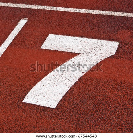 Close up of number seven on a running-track